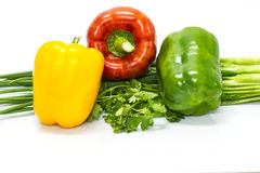 Colored peppers with Fresh vegetables Stock Images