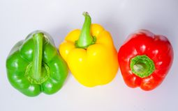 Colored peppers. Green, yellow and red pepper Stock Photos