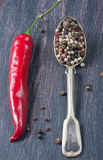 Colored peppers mix, red chilly peppers  on a wooden table Stock Photography