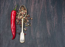 Colored peppers mix, red chilly peppers  on a wooden table Royalty Free Stock Photos