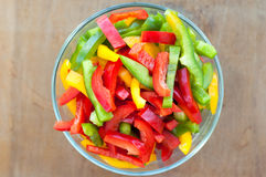 Colored peppers mixed in a bowl. Colored peppers mixed in a glass bowl Stock Images