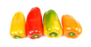 Colored peppers over white background. stock photo