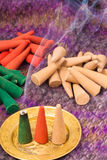 Colored and perfumed incense cones burning Royalty Free Stock Photography