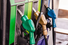 Colored petrol gas pump nozzles Stock Photo