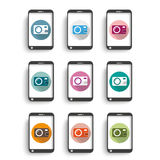 9 Colored Photocamera Icons Smartphones. Photocamera icons with smartphones on the white background royalty free illustration