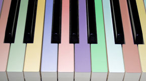 Colored piano keys. Close up of a colored piano keyboard stock photos