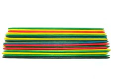 Colored pick-up-sticks. Different colored pick up sticks with white background Royalty Free Stock Photography
