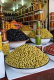 Colored pickled olives and vegetables on a market stall Stock Images