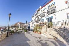 Colored picturesque houses, street.Typical neighborhood histori. C center, casco antiguo,barrio santa cruz.Alicante, Spain Stock Images