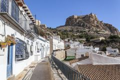 Colored picturesque houses, street.Typical neighborhood histori. C center, casco antiguo,barrio santa cruz.Alicante, Spain Royalty Free Stock Photography
