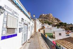 Colored picturesque houses, street.Typical neighborhood histori. C center, casco antiguo,barrio santa cruz.Alicante, Spain Stock Photo
