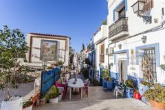 Colored picturesque houses, street.Typical neighborhood histori. C center, casco antiguo,barrio santa cruz.Alicante, Spain Royalty Free Stock Photo