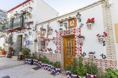 Colored picturesque houses, street.Typical neighborhood histori. C center, casco antiguo,barrio santa cruz.Alicante, Spain Royalty Free Stock Images