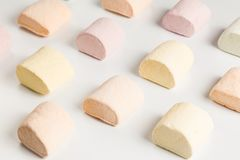 Colored pieces of marshmallow on the production line. Useful for food background presemtation stock photography