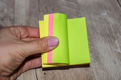 Colored pieces of paper in hand stock photos