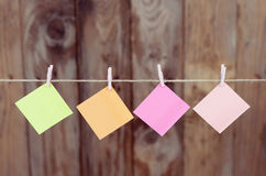 Colored pieces of paper hanging on a rope Stock Photos