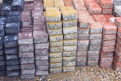 Colored piles of concrete paving slab outdoors. royalty free stock image
