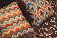 Colored pillow with pattern on bed. Rest, sleeping, comfort concept stock photography