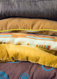 Colored pillows. Background of a five colored pillows Stock Photography