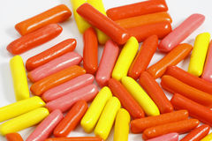 Colored pills. On the white background Royalty Free Stock Photo