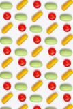 Colored pills arranged in row - pattern Royalty Free Stock Photography