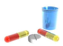 Colored pills and blue glass of water on white bac Royalty Free Stock Photography