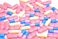 Colored pills and capsules Stock Photos