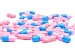 Colored pills and capsules on a white background Stock Photo