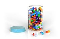 Colored pills in the container. Royalty Free Stock Photography