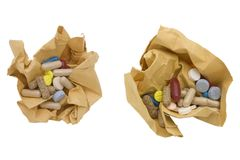 Colored pills and crumpled paper Stock Images