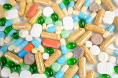 Colored pills isolated on white background Royalty Free Stock Photography