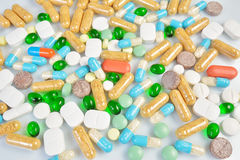 Colored pills isolated on white background Stock Photos