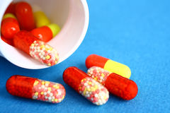 Colored pills and a jar Royalty Free Stock Photography