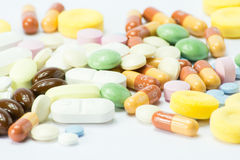 Colored pills over white baackground Stock Photography
