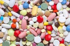 Colored pills, tablets and capsules Royalty Free Stock Photo