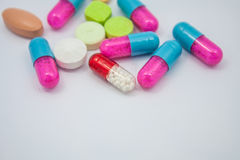 Colored pills, tablets and capsules Royalty Free Stock Photography