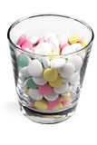 Colored pills in a transparent glass royalty free stock photo