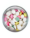 Colored pills in a transparent glass , top Royalty Free Stock Photo