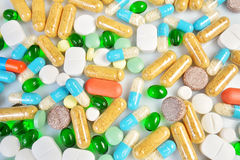 Colored pills  on white background Royalty Free Stock Photo
