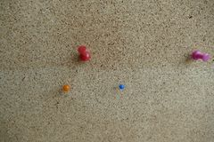 Colored pin in an office pinboard. A colored pin in an office pinboard Stock Photo