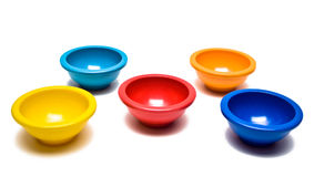 Colored Pinch Bowls. In red, yellow, blue, and orange on white background Stock Image