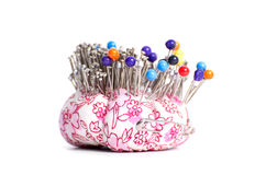 Colored pinheads in pin-cushion Royalty Free Stock Photography
