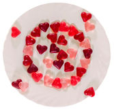 Colored (pink, red and orange), transparent heart shape jellies with ceramic plate, white background Stock Photography