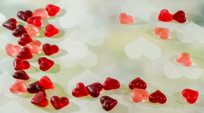 Colored (pink, red and orange), transparent heart shape jellies, heart light background Royalty Free Stock Photo