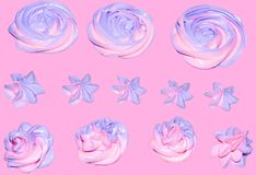 Colored pink-violet marshmallow in the form of a flower for decoration of a festive dessert on an isolated pink pastel background. Colored pink-violet stock image