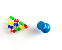 Colored pins. Detail the different colored pins on a white background Royalty Free Stock Photography