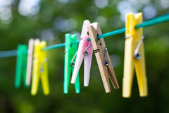 Colored Plastic And Wooden Clothes Pegs Royalty Free Stock Photography