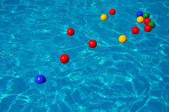 Colored plastic balls in a swimming pool Royalty Free Stock Images