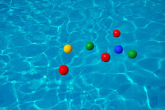 Colored plastic balls in a swimming pool Royalty Free Stock Photo