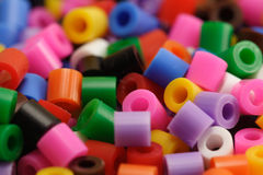 Colored plastic beads. Macro of a group of plastic beads of many colors Royalty Free Stock Image